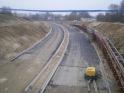Budowa ulicy Obiegowej i biegnącej przy niej linii tramwajowej - widok z wiaduktu ulicy Żołnierskiej (16 listopada 2014)